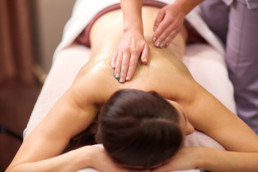 woman having back massage with gel at spa